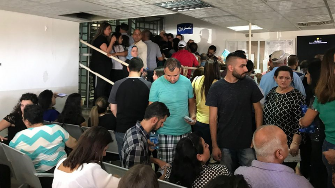 people waiting in the DCO office at Etzion, 2019