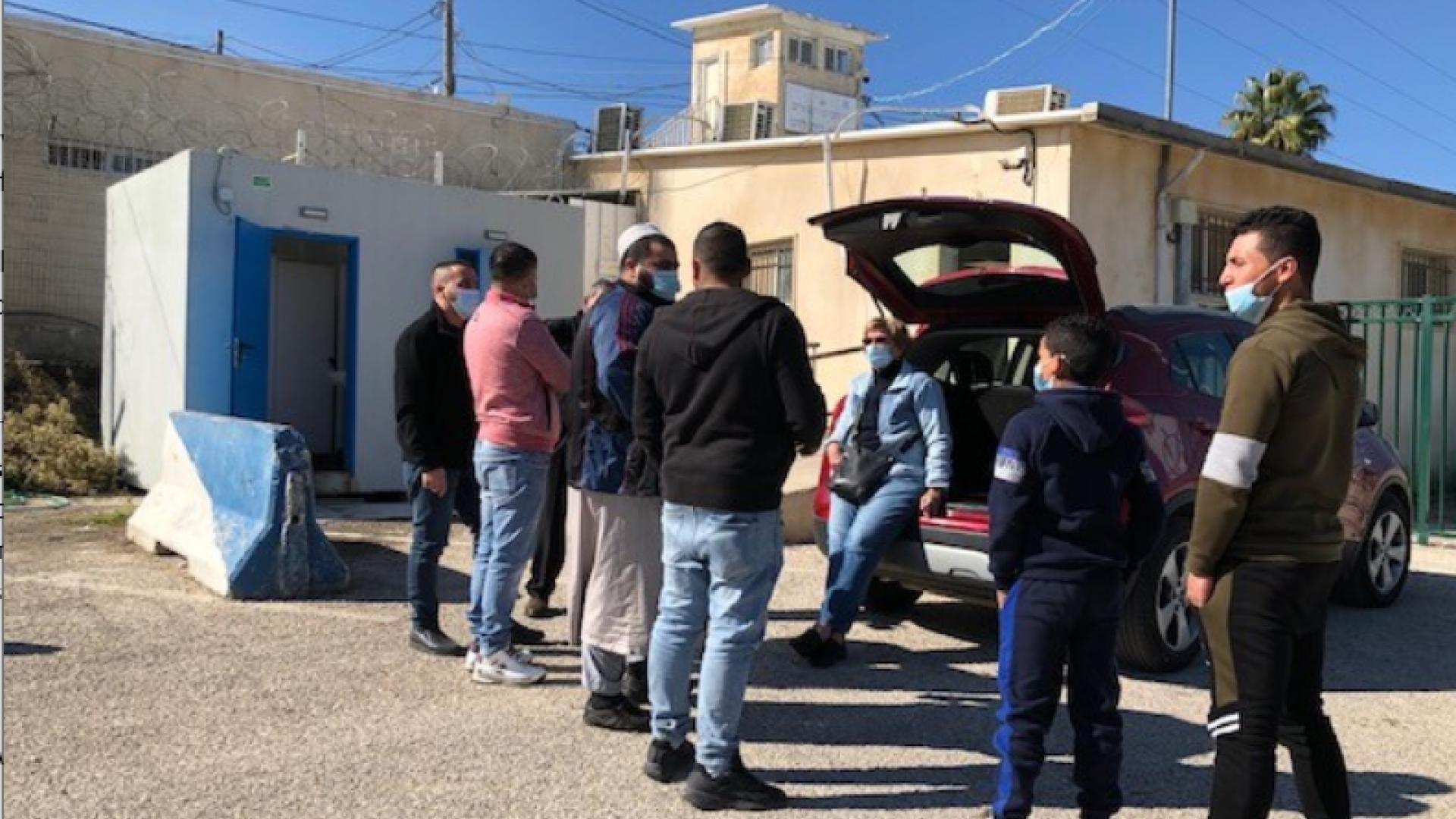 MachsomWatch volunteers  speaking with Palestinians In DCO Etzion